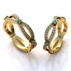 Кольцо из желтого золота с бриллиантами и изумрудами..