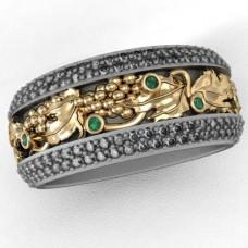 Кольцо из комбинированного золота с  изумрудами