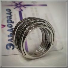 Экстравагантное кольцо из белого золота с изумрудами