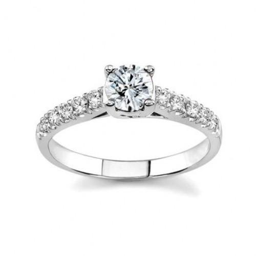 Кольцо для предложения из белого золота с большим и мелкими бриллиантами