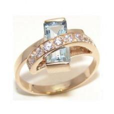 Кольцо из красного золота с бриллиантами и топазом..
